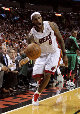 MIAMI, FL - APRIL 10:  LeBron James #6 of the Miami Heat looks to pass during a game against the Boston Celtics at American Airlines Arena on April 10, 2011 in Miami, Florida. NOTE TO USER: User expressly acknowledges and agrees that, by downloading and/o