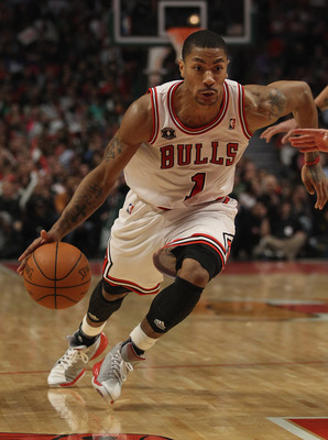 CHICAGO, IL - APRIL 07: Derrick Rose #1  of the Chicago Bulls moves against the Boston Celtics at United Center on April 7, 2011 in Chicago, Illinois. The Bulls defeated the Celtics 97-81. NOTE TO USER: User expressly acknowledges and agress that, by down