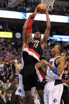 DALLAS, TX - JANUARY 04:  Forward LaMarcus Aldridge #12 of the Portland Trail Blazers takes a shot against Shawn Marion #0 of the Dallas Mavericks at American Airlines Center on January 4, 2011 in Dallas, Texas.  NOTE TO USER: User expressly acknowledges