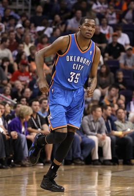 PHOENIX, AZ - MARCH 30:  Kevin Durant #35 of the Oklahoma City Thunder reacts after hitting a three point shot against the Phoenix Suns during the NBA game at US Airways Center on March 30, 2011 in Phoenix, Arizona.  The Thunder defeated the Suns 116-98.