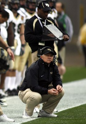 JACKSONVILLE, FL - DECEMBER 02:  Head coach Jim Grobe of the Wake Forest Demon Deacons keels on the sidelines during a game against the Georgia Tech Yellow Jackets during the Atlantic Coast Conference Championship on December 2, 2006 at Alltel Stadium in
