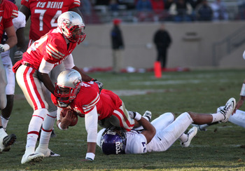 ALBUQUERQUE, NM - NOVEMBER 27: Quarterback Stump Godfrey #11 of the University of New Mexico Lobos is tackled by Jason Teague #27 of the TCU Horned Frogs on November 27, 2010 at University Stadium in Albuquerque, New Mexico. TCU won 66-17. (Photo by Eric