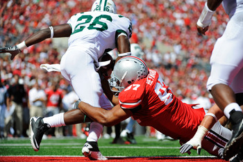 COLUMBUS, OH - SEPTEMBER 18:  Cameron Heyward #97 of the Ohio State Buckeyes tackles Vince Davidson #26 of the Ohio Bobcats in the endzone for a safety in the third quarter at Ohio Stadium on September 18, 2010 in Columbus, Ohio. The Buckeyes defeated the