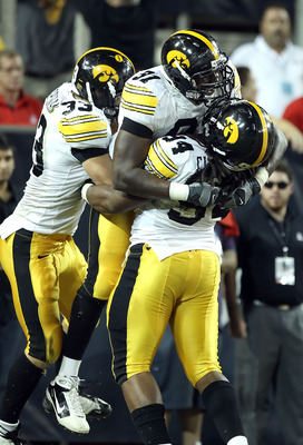 TUCSON, AZ - SEPTEMBER 18:  Defensive end Broderick Binns #91 of the Iowa Hawkeyes celebrates after scoring a touchdown during the college football game against the Arizona Wildcats at Arizona Stadium on September 18, 2010 in Tucson, Arizona. The Wildcats