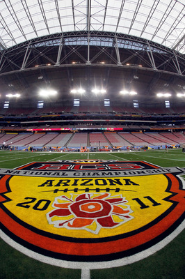 GLENDALE, AZ - JANUARY 10:  A view of the logo at mid-field at the Tostitos BCS National Championship Game before the Oregon Ducks and the Auburn Tigers take the field at University of Phoenix Stadium on January 10, 2011 in Glendale, Arizona.  (Photo by J