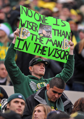 CORVALLIS, OR - DECEMBER 4: An Oregon Ducks fan holds up a sign featuring head coach Chip Kelly of the Oregon Ducks in the fourth quarter of the game against the the Oregon State Beavers at Reser Stadium on December 4, 2010 in Corvallis, Oregon. The Ducks
