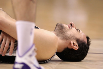 PHOENIX, AZ - APRIL 13:  Manu Ginobili #20 of the San Antonio Spurs reacts after an injury in the NBA game against the Phoenix Suns at US Airways Center on April 13, 2011 in Phoenix, Arizona.  NOTE TO USER: User expressly acknowledges and agrees that, by