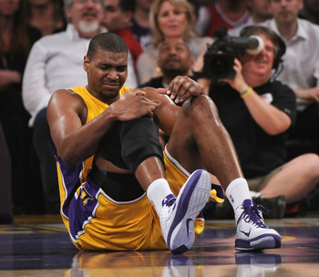 LOS ANGELES, CA - APRIL 12:  Andrew Bynum #17 of the Los Angeles Lakers grimaces after an injury against the San Antonio Spurs at Staples Center on April 12, 2011 in Los Angeles, California.  NOTE TO USER: User expressly acknowledges and agrees that, by d