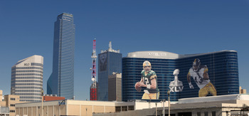 DALLAS, TX - FEBRUARY 5: General view of the downtown skyline with Super Bowl XLV art draped from the Omni Hotel as motorists make their way along on February 5, 2011 in Dallas, Texas. The Green Bay Packers will play the Pittsburgh Steelers in Super Bowl