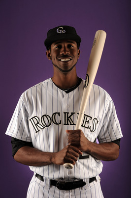SCOTTSDALE, AZ - FEBRUARY 24:  Dexter Fowler #24 of the Colorado Rockies poses for a portrait during photo day at the Salt River Fields at Talking Stick on February 24, 2011 in Scottsdale, Arizona.  (Photo by Harry How/Getty Images)