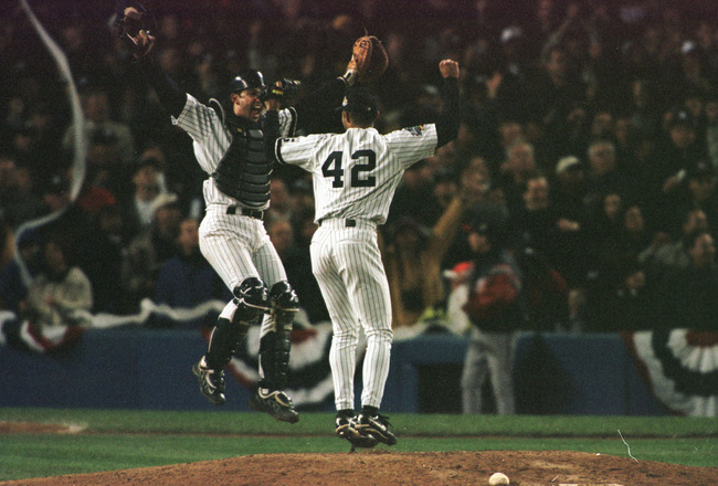 27 Oct 1999:  Catcher Jorge Posada of the New York Yankees leaps into the air with Mariano Rivera after they defeated the Atlanta Braves 4-1 in game four of the Major League Baseball World Series at Yankees Stadium in New York, New York, to win the Series
