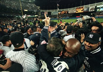27 Oct 1999: Chille Davis #45 of the New York Yankees hugs the team after winning the World Series Game four against the Atlanta Braves at Yankee Stadium in the Bronx, New York. The Yankees defeated the Braves 4-1.