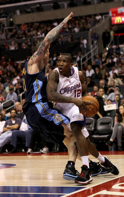 LOS ANGELES, CA - MARCH 5: Eric Bledsoe #12 of the Los Angeles Clippers drives against Chris Andersen #11 of the Denver Nuggets at Staples Center on March 5, 2011 in Los Angeles, California.  The Clippers won 100-94. NOTE TO USER: User expressly acknowled