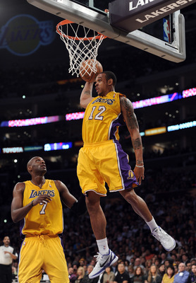 LOS ANGELES, CA - APRIL 12:  Shannon Brown #12 of the Los Angeles Lakers grabs a rebound in front of Lamar Odom #7 against the San Antonio Spurs during the game at Staples Center on April 12, 2011 in Los Angeles, California.  NOTE TO USER: User expressly