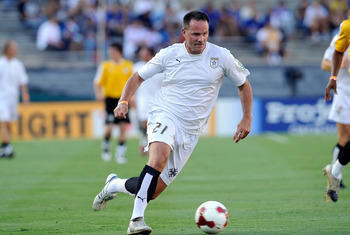 PASADENA, CA - JULY 21:  Former USNational team footballer Eric Wynalda paces the ball on the attack during a soccer celebrity game prior to the World Football Challenge between Chelsea FC and Inter Milan at the Rose Bowl on July 21, 2009 in Pasadena, Cal