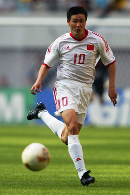 SEOUL - JUNE 13:  Haidong Hao of China runs with the ball during the FIFA World Cup Finals 2002 Group C match between Turkey and China played at the Seoul World Cup Stadium, in Seoul, South Korea on June 13, 2002. Turkey won the match 3-0. DIGITAL IMAGE.
