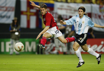 SAPPORO - JUNE 7:  Michael Owen (No.10) of England shoots towards goal while Diego Placente of Argentina looks on during the England v Argentina, Group F, World Cup Group Stage match played at the Sapporo Dome in Sapporo, Japan on June 7, 2002. England wo