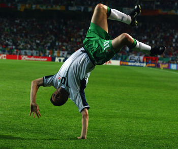 SUWON - JUNE 16:  Robbie Keane of the Republic of Ireland celebrates scoring a dramatic penalty kick during the FIFA World Cup Finals 2002 Second Round match between Spain and Republic of Ireland played at the Suwon World Cup Stadium, in Suwon, South Kore