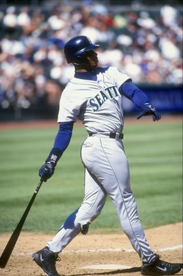 17 Sep 1998: Ken Griffey Jr. #24 of the Seattle Mariners drops his bat as he watches the ball fly during the game agianst the Oakland Athletics at Oakland Coliseum in Oakland, California. The Mariners defeated the A''s 8-0.