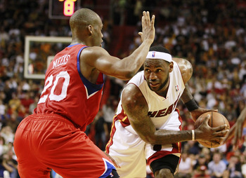 MIAMI, FL - MARCH 25:  Forward LeBron James #6  of the Miami Heat drives against Guard Jodie Meeks #20 of the Philadelphia 76ers at American Airlines Arena on March 25, 2011 in Miami, Florida. The Heat defeated the Sixers 111-99. NOTE TO USER: User expres