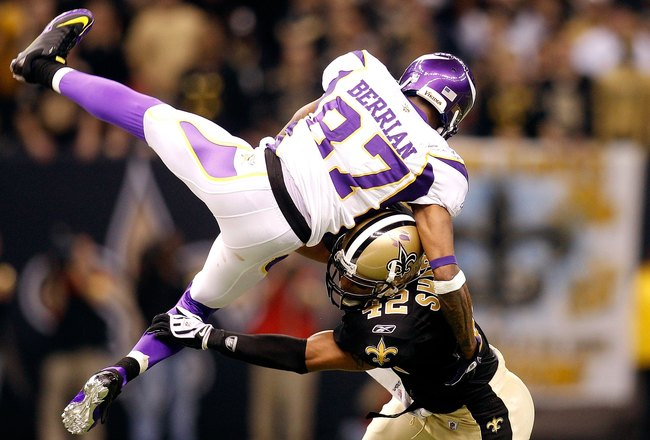 NEW ORLEANS - JANUARY 24:  Darren Sharper #42 of the New Orleans Saints hits Bernard Berrian #87 of the Minnesota Vikings during the NFC Championship Game at the Louisiana Superdome on January 24, 2010 in New Orleans, Louisiana. The Saints won 31-28. (Pho