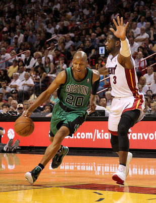 MIAMI, FL - APRIL 10: Ray Allen #20 of the Boston Celtics drives against Dwyane Wade #3 of the Miami Heat during a game at American Airlines Arena on April 10, 2011 in Miami, Florida. NOTE TO USER: User expressly acknowledges and agrees that, by downloadi