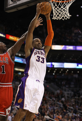PHOENIX - NOVEMBER 24:  Grant Hill #33 of the Phoenix Suns slam dunks during the NBA game against the Chicago Bulls at US Airways Center on November 24, 2010 in Phoenix, Arizona. The Bulls defeated the Suns 123-115 in double overtime. NOTE TO USER: User e