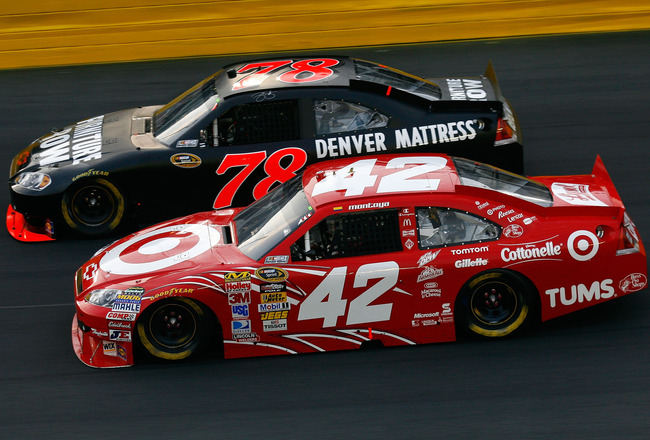 CONCORD, NC - MAY 22:  Juan Pablo Montoya, driver of the #42 Target Chevrolet, and Regan Smith, driver of the #78 Furniture Row Racing Chevrolet, race side by side during the NASCAR Sprint Showdown at Charlotte Motor Speedway on May 22, 2010 in Concord, N