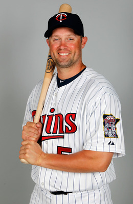 FORT MYERS, FL - FEBRUARY 25:  Outfielder Michael Cuddyer #5 of the Minnesota Twins poses for a photo during photo day at Hammond Stadium on February 25, 2011 in Fort Myers, Florida.  (Photo by J. Meric/Getty Images)