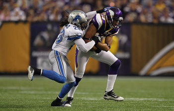 MINNEAPOLIS - SEPTEMBER 26:  Wide receiver Hank Baskett #19 of the Minnesota Vikings is brought down by Louis Delmas #26 of the Detroit Lions at Mall of America Field on September 26, 2010 in Minneapolis, Minnesota. The Vikings defeated the Lions 24-10.