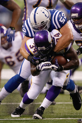 INDIANAPOLIS, IN - AUGUST 14: Running back Albert Young #34 of the Minnesota Vikings runs with the football as he is tackled by linebacker Adam Seward #52 of the Indianapolis Colts at Lucas Oil Stadium on August 14, 2009 in Indianapolis, Indiana. The Viki