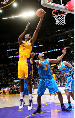 LOS ANGELES, CA - JANUARY 7:  Lamar Odom #7 of the Los Angeles Lakers shoots over David West #30 of the New Orleans Hornets at Staples Center on January 7, 2011 in Los Angeles, California.  The Lakers won 101-97.  NOTE TO USER: User expressly acknowledges