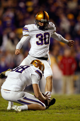 BATON ROUGE, LA - NOVEMBER 28:  Josh Jasper #30 of the LSU Tigers kicks a field goal against the Arkansa Razorbacks at Tiger Stadium on November 28, 2009 in Baton Rouge, Louisiana.  The Tigers defeated the Razorbacks 33-30 in overtime.  (Photo by Chris Gr