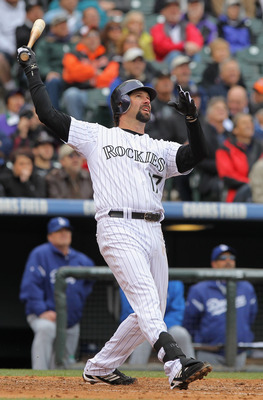 DENVER, CO - APRIL 06:  First baseman Todd Helton #17 of the Colorado Rockies watches his three run homerun off of starting pitcher Chad Billingsley #58 of the Los Angeles Dodgers to give the Rockies a 5-4 lead in the third inning at Coors Field on April
