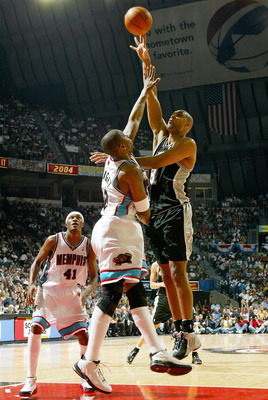 MEMPHIS, TN - APRIL 25:  Tim Duncan #21 of San Antonio Spurs puts up a shot over Lorenzen Wright #42 of the Memphis Grizzlies during Game four of Western Conference Quarterfinals of the 2004 NBA Playoffs April 25, 2004 at The Pyramid in Memphis Tennessee.
