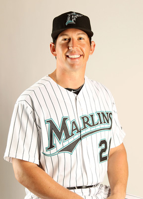 JUPITER, FL - FEBRUARY 23:  John Baker #21 of the Florida Marlins during Photo Day at Roger Dean Stadium on February 23, 2011 in Jupiter, Florida.  (Photo by Mike Ehrmann/Getty Images)
