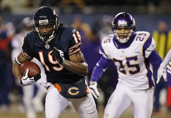 CHICAGO - DECEMBER 28:  Devin Aromashodu #19 of the Chicago Bears runs after a catch in front of Tyrell Johnson #25 of the Minnesota Vikings in the second quarter at Soldier Field on December 28, 2009 in Chicago, Illinois. (Photo by Jonathan Daniel/Getty