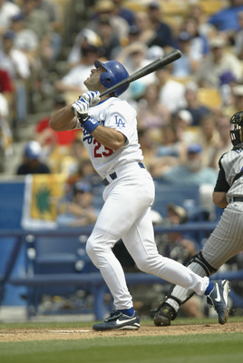 LOS ANGELES - JUNE 2:  Eric Karros #23 of the Los Angeles Dodgers bats during their game versus the Arizona Diamondbacks at Dodger Stadium in Los Angeles, California on June 2, 2002.  The Dodgers won 6-3. (Photo by Stephen Dunn/Getty Images)