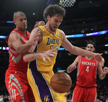 LOS ANGELES, CA - FEBRUARY 01:  Pau Gasol #16 of the Los Angeles Lakers and Shane Battier #31 of the Houston Rockets battle for a rebound in the first half at Staples Center on February 1, 2011 in Los Angeles, California. The Lakers defeated the Rockets 1