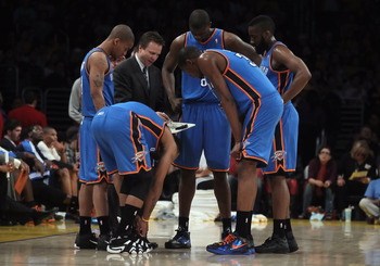 LOS ANGELES, CA - APRIL 10:  Oklahoma City Thunder head coach Scott Brooks draws up a play for his team during a timeout in the first half against the Los Angeles Lakers at Staples Center on April 10, 2011 in Los Angeles, California. The Thunder defeated