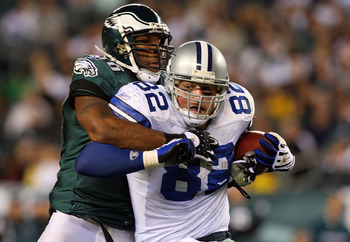 PHILADELPHIA - DECEMBER 28:  Omar Gaither #96 of the Philadelphia Eagles tackles Jason Witten #82 of the Dallas Cowboys on December 28, 2008 at Lincoln Financial Field in Philadelphia, Pennsylvania. The Eagles defeated the Cowboys 44-6.  (Photo by Jim McI