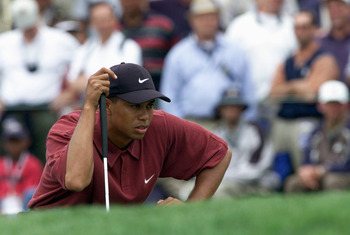 MONTEREY - JUNE 18:  Tiger Woods lines up a putt on the first green during the final round of the 100th US Open at Pebble Beach on June 18,2000 in Monterey, California.  (Mandatory Credit: Jonathan Ferrey/Getty Images)