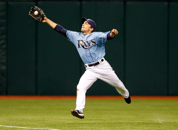 ST. PETERSBURG, FL - APRIL 03:  Outfielder Sam Fuld #5 of the Tampa Bay Rays catches a ball against the Baltimore Orioles during the game at Tropicana Field on April 3, 2011 in St. Petersburg, Florida.  (Photo by J. Meric/Getty Images)