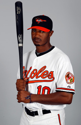 SARASOTA, FL - FEBRUARY 26:  Outfielder Adam Jones #10 of the Baltimore Orioles poses for a photo during photo day at Ed Smith Stadium on February 26, 2011 in Sarasota, Florida.  (Photo by J. Meric/Getty Images)