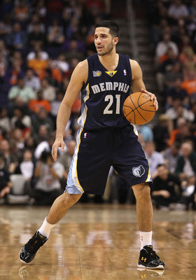 PHOENIX - DECEMBER 08:  Greivis Vasquez #21 of the Memphis Grizzlies handles the ball against the Phoenix Suns during the NBA game at US Airways Center on December 8, 2010 in Phoenix, Arizona. NOTE TO USER: User expressly acknowledges and agrees that, by
