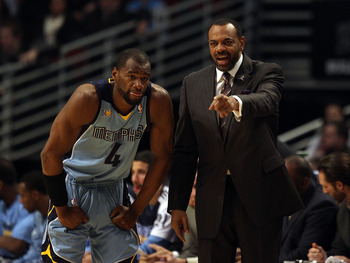 CHICAGO, IL - MARCH 25: Head coach Lionel Hollins  of the Memphis Grizzlies gives instructions to Sam Young #4 during a game against the Chicago Bulls at the United Center on March 25, 2011 in Chicago, Illinois. The Bulls defeated the Grizzlies 99-96. NOT