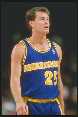 12 Mar 1997: Guard Mark Price of the Golden State Warriors stands on the court during a game against the Los Angeles Lakers at the Great Western Forum in Inglewood, California. The Lakers won the game 109-101.