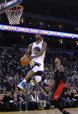 OAKLAND, CA - MARCH 25: Dorell Wright #1 of the Golden State Warriors goes up for a dunk on James Johnson #0 of the Toronto Raptors at Oracle Arena on March 25, 2011 in Oakland, California. NOTE TO USER: User expressly acknowledges and agrees that, by dow