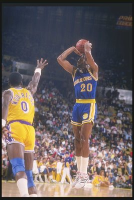 1989-1990:  Terry Teagle of the Golden State Warriors jumps in the air with the basketball. Mandatory Credit: Ken Levine  /Allsport