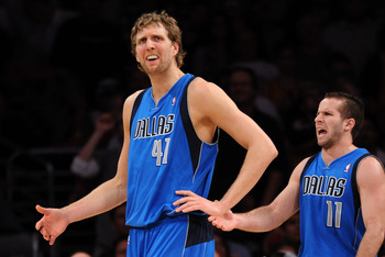 LOS ANGELES, CA - MARCH 31:  Dirk Nowitzki #41 and Jose Barea #11 of the Dallas Mavericks react to a foul during the game against the Los Angeles Lakers at Staples Center on March 31, 2011 in Los Angeles, California.  NOTE TO USER: User expressly acknowle